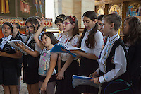 """Romania. Iași County. Iasi. A youth singing choir in the Orthodox Church """"Saint Nektarios"""". Iași (also referred to as Iasi, Jassy or Iassy) is the largest city in eastern Romania and the seat of Iași County. Located in the Moldavia region, Iași has traditionally been one of the leading centres of Romanian social life. The city was the capital of the Principality of Moldavia from 1564 to 1859, then of the United Principalities from 1859 to 1862, and the capital of Romania from 1916 to 1918. 6.06.15 © 2015 Didier Ruef"""