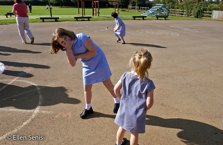 MR / Abingdon, Oxfordshire, England.Thomas Reade Primary School.Girl (9, with special educational needs - S.E.N.) laughing in schoolyard.  .MR: Web2.©Ellen B. Senisi