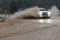 A motorist plows through a flooded section of Arkansas 12 on Wednesday April 28 2021 near Beaver Lake east of Rogers. Go to nwaonline.com/210428Daily/ to see more photos.<br />
