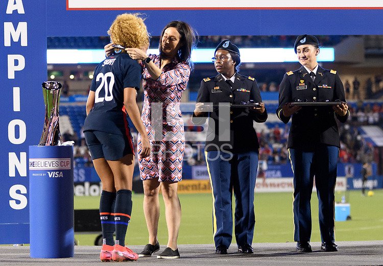 FRISCO, TX - MARCH 11: Casey Short #20 of the United States receives her medal during a game between Japan and USWNT at Toyota Stadium on March 11, 2020 in Frisco, Texas.