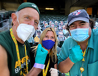 OAKLAND, CA - SEPTEMBER 19: Photographers Michael Zagaris, Brad Mangin, and Jean Fruth pose for a picture while wearing masks after the game between the San Francisco Giants and Oakland Athletics at the Oakland Coliseum on Saturday, September 19, 2020 in Oakland, California. (Photo by Brad Mangin)