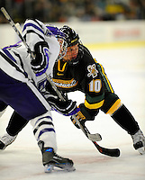 29 December 2007: University of Vermont Catamounts' forward Colin Vock, a Sophomore from Plymouth, MI, in action against the Holy Cross Crusaders at Gutterson Fieldhouse in Burlington, Vermont. The Catamounts rallied in the final seconds of play to tie the game 1-1. After overtime, although the official result remained a tie game, the Cats moved up to the championship round by winning a sudden death shootout in the second game of the Sheraton/TD Banknorth Catamount Cup Tournament...Mandatory Photo Credit: Ed Wolfstein Photo