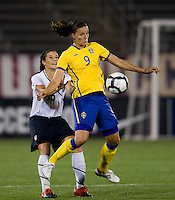 Ali Krieger (16) of the USWNT tries to keep control of Jessica Landstrom (9) of Sweden at Rentschler Field in East Hartford, Connecticut.  The USWNT defeated Sweden, 3-0.