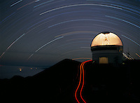 "Gemini North Telescope, with star trails behind.  ""Transparent dome"" effect caused by rotating dome while camera shutter was open..Mauna Kea Observatory, Hawaii."