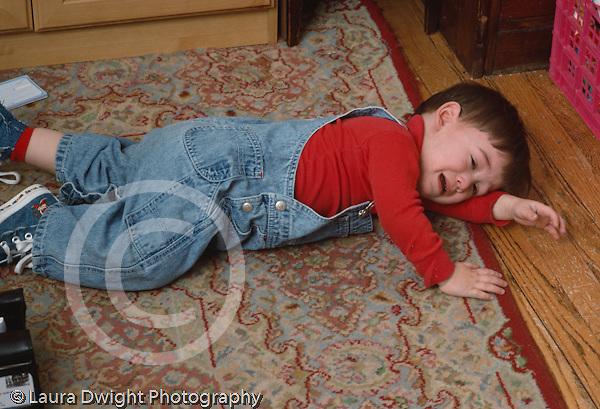 18 month old toddler boy lying on floor tantrum horizontal