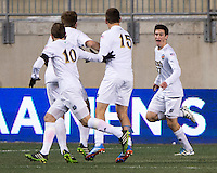 Patrick Hodan (27) of Notre Dame celebrates his goal with teammates during the NCAA Men's College Cup semifinals at PPL Park in Chester, PA.  Notre Dame defeated New Mexico, 2-0.