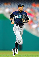 21 June 2011: Seattle Mariners right fielder Ichiro Suzuki returns to the dugout during action against the Washington Nationals at Nationals Park in Washington, District of Columbia. The Nationals rallied from a 5-1 deficit, scoring 5 runs in the bottom of the 9th, to defeat the Mariners 6-5 in inter-league play. Mandatory Credit: Ed Wolfstein Photo
