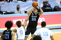 CHAPEL HILL, NC - FEBRUARY 24: Jose Perez #55 of Marquette shoots over Anthony Harris #0 of North Carolina during a game between Marquette and North Carolina at Dean E. Smith Center on February 24, 2021 in Chapel Hill, North Carolina.