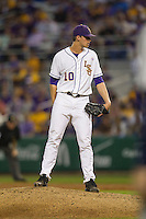 LSU Tigers pitcher Aaron Nola #10 looks to his catcher for the sign against the Auburn Tigers in the NCAA baseball game on March 22nd, 2013 at Alex Box Stadium in Baton Rouge, Louisiana. LSU defeated Auburn 9-4. (Andrew Woolley/Four Seam Images).