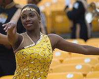 A member of the Grambling State Tigers Orchesis Dance Company performs in the stands of Heinz Field, Pittsburgh, Pennsylvania before the football game between the Tigers and the Pitt Panthers on September 08, 2007.