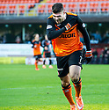 Dundee Utd's Nadir Ciftci celebrates after he scores their first goal.