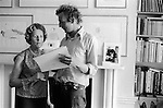 Patrick Procktor artist London 1968. Patrick with his mother Barbara in the Manchester Street flat.He is showing her some of my photographs. On the mantle piece is an image of PP and Gervase, his close friend. 1999