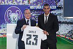 Real Madrid's new signing Danilo, right, displays his new shirt alongside club president Florentino Perez during his presentation at the Santiago Bernabeu stadium in Madrid, Spain. July 09, 2015. (ALTERPHOTOS/Victor Blanco)