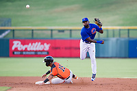 AZL Cubs shortstop Delvin Zinn (21) avoids the slide of Ricardo Genoves (15) on a double play attempt against the AZL Giants on July 17, 2017 at Sloan Park in Mesa, Arizona. AZL Giants defeated the AZL Cubs 12-7. (Zachary Lucy/Four Seam Images)