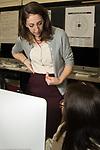 Education high school classroom scenes female teacher talking with female student