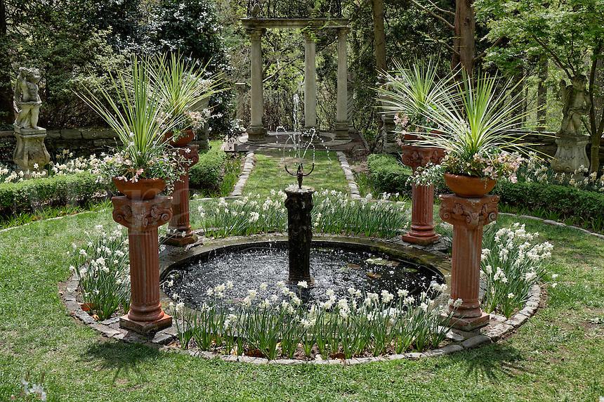 Water fountain feature in formal garden.