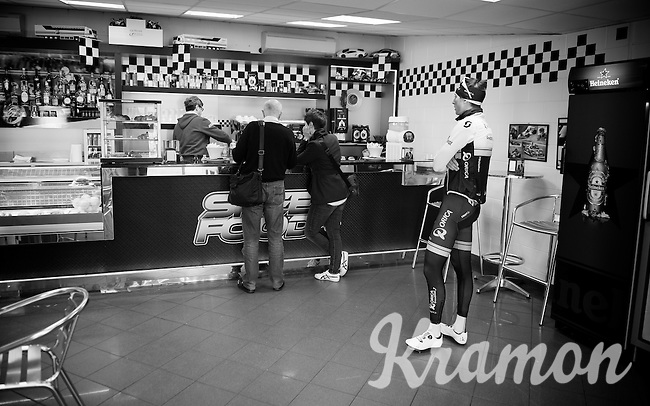 everyday life for pro-riders: Jens Keukeleire (BEL/Orica-GreenEDGE) ordering coffee while on a training/coffee ride with Team Orica-GreenEDGE at Monza (race circuit park) 1 day before Milan-San Remo