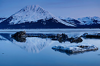 Spring Landscape of  ice bergs and the calm waters of Turnagain Arm reflecting the Kenai Mountains in the background south of Anchorage. <br /> <br /> <br /> Photo by Jeff Schultz/  (C) 2020  ALL RIGHTS RESERVED
