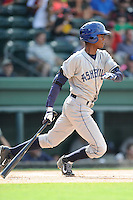 Left fielder Raimel Tapia (15) of the Asheville Tourists bats in a game against the Greenville Drive on Sunday, July 20, 2014, at Fluor Field at the West End in Greenville, South Carolina. Tapia is the No. 10 prospect of the Colorado Rockies, according to Baseball America. Asheville won game two of a doubleheader, 3-2. (Tom Priddy/Four Seam Images)