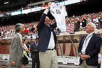 New Jersey Governor Jon S. Corzine displays an autographed jersey presented to him by US Soccer Federation president Sunil Gulati prior to the match. The men's national teams of the United States and Argentina played to a 0-0 tie during an international friendly at Giants Stadium in East Rutherford, NJ, on June 8, 2008.