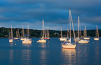 Canada Mahone Bay Nova Scotia marina harbor at sunset with glow from sun on boats small village in relaxing tourist town