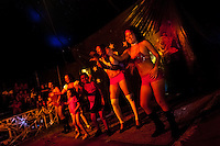 Salvadorean women with their children perform a dancing act at the Circo Brasilia, a family run circus travelling in Central America, 10 May 2011. The Circo Brasilia circus belongs to the old-fashioned traveling circuses with a usual mixture of acrobat, clown and comic acts. Due to the general loss of popularity caused by modern forms of entertainment such as movies, TV shows or internet, these small family enterprises balance on the edge of survival. Circuses were pushed away and now they have to set up their shows in more remote villages. The circus art and culture is slowly dying in Latin America.