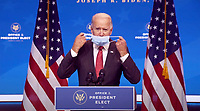 United States President-elect Joe Biden removes his mask prior to making remarks following his virtual meeting with the National Governors Association's Executive Committee in Wilmington, Delaware on Monday, November 16, 2020.  <br /> Credit: Biden Transition via CNP /MediaPunch