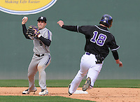 Infielder Kyle Ruchim (9) of the Northwestern Wildcats turns a double play on Paul Nitto (18) of the Furman University Paladins on Saturday, February 16, 2013, at Fluor Field in Greenville, South Carolina. The game was cancelled in the fifth inning due to snow. (Tom Priddy/Four Seam Images)