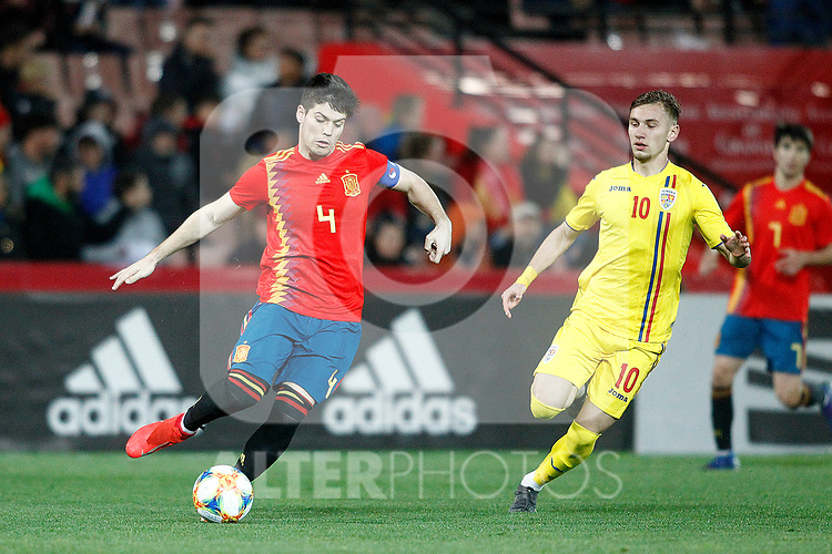 Spain's Jorge Mere and Romania's Dragus Denis  during the International Friendly match on 21th March, 2019 in Granada, Spain. (ALTERPHOTOS/Alconada)