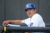 Burlington Royals hitting coach Jesus Azuaje (35) watches the action from the dugout during the game against the Bluefield Blue Jays at Burlington Athletic Stadium on June 28, 2016 in Burlington, North Carolina.  The Royals defeated the Blue Jays 4-0.  (Brian Westerholt/Four Seam Images)