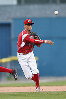 Batavia Muckdogs shortstop Aaron Blanton (11) throws to first during a game against the Jamestown Jammers on July 7, 2014 at Dwyer Stadium in Batavia, New York.  Batavia defeated Jamestown 9-2.  (Mike Janes/Four Seam Images)