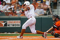 Texas Longhorns outfielder Ben Johnson #14 swings the bat during the NCAA baseball game against the Oklahoma State Cowboys on April 26, 2014 at UFCU Disch–Falk Field in Austin, Texas. The Cowboys defeated the Longhorns 2-1. (Andrew Woolley/Four Seam Images)