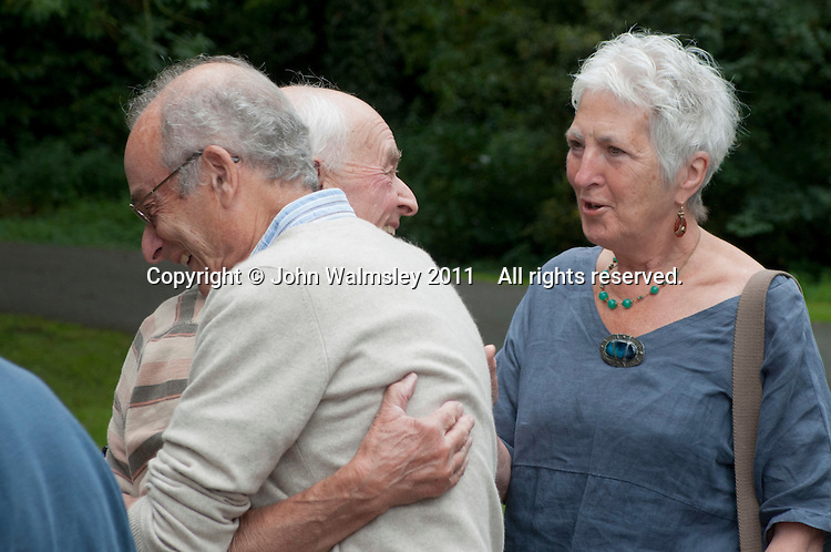 Old friends greeting each other.  Reunion for Summerhill School's 90th birthday celebrations.