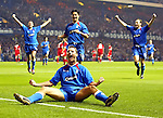 Peter Lovenkrands sends Ibrox wild as he scores Rangers second goal against Stuttgart in the Champions League as team-mates Shota Arveladze, Michael Mols and Christian Nerlinger rush in to celebrate