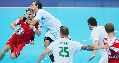 08 AUG 2012 - LONDON, GBR - Aron Palmarsson (ISL) of Iceland (left) finds his path to goal blocked by Gergely Harsanyi (HUN) of Hungary (second from left) during the men's London 2012 Olympic Games quarter final match at the Basketball Arena in the Olympic Park, in Stratford, London, Great Britain .(PHOTO (C) 2012 NIGEL FARROW)