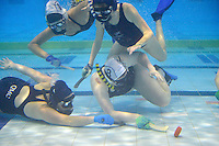 Action from the Underwater Hockey Premier  at Wellington Regional Aquatic Centre, Wellington, New Zealand on Tuesday 3  June 2014. <br /> Photo by Masanori Udagawa. <br /> www.photowellington.photoshelter.com.