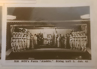 BNPS.co.uk (01202 558833)<br /> Pic: TheCotswoldAuctionCompany/BNPS<br /> <br /> Pictured: The performance of 'Aladdin' at Stalag Luft in January 1943.<br /> <br /> A remarkable cache of rarely seen photos capturing life inside the Great Escape PoW camp has been discovered in a barn.<br /> <br /> The images, taken at Stalag Luft III in 1942 and 1943, show Allied prisoners dressed as women doing amateur-dramatics and an action-packed sports day.<br /> <br /> They donned bikinis and other extravagant outfits as they entertained their camp mates with performances of 'Aladdin' and 'Girls, Girls, Girls'.<br /> <br /> Hundreds of PoWs perched on roofs to watch the sports day which featured sprint races, the long jump, the high jump and a discus competition.