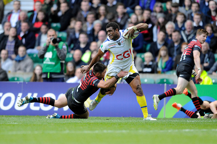 Napolioni Nalaga of ASM Clermont Auvergne is tackled by Brad Barritt of Saracens during the Heineken Cup semi-final match between Saracens and ASM Clermont Auvergne at Twickenham Stadium on Saturday 26th April 2014 (Photo by Rob Munro)