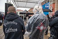 """AfD-Kundgebung in Potsdam.<br /> Ca. 70 AfD-Anhaenger kamen am Samstag den 9. September 2017 zu einer Wahlveranstaltung der rechtsnationalistischen """"Alternative fuer Deutschland"""", AfD. Unter den Teilnehmern waren u.a. Neonazis die """"Patrioten Cottbus"""" oder die sog. """"Schwarze Sonne"""", ein Zeichen der SS auf ihren Jacken trugen. Offiziell hatte die AfD die Kundgebung als Gruendung einer rechten Gewerkschaft namens """"Alternativer Arbeitnehmerverband Mitteldeutschland"""" (Alarm) in Brandenburg deklariert.<br /> 500 Menschen protestierten friedlich gegen die Veranstaltung.<br /> Im Bild vlnr: Lutz Mamcarz mit der Aufschrift """"Partioten Cottbus"""" auf der Jacke und Sylvia Fechner mit der """"Schwarzen Sonne"""", dem SS-Symbol, auf der Jacke. <br /> 9.9.2017, Potsdam<br /> Copyright: Christian-Ditsch.de<br /> [Inhaltsveraendernde Manipulation des Fotos nur nach ausdruecklicher Genehmigung des Fotografen. Vereinbarungen ueber Abtretung von Persoenlichkeitsrechten/Model Release der abgebildeten Person/Personen liegen nicht vor. NO MODEL RELEASE! Nur fuer Redaktionelle Zwecke. Don't publish without copyright Christian-Ditsch.de, Veroeffentlichung nur mit Fotografennennung, sowie gegen Honorar, MwSt. und Beleg. Konto: I N G - D i B a, IBAN DE58500105175400192269, BIC INGDDEFFXXX, Kontakt: post@christian-ditsch.de<br /> Bei der Bearbeitung der Dateiinformationen darf die Urheberkennzeichnung in den EXIF- und  IPTC-Daten nicht entfernt werden, diese sind in digitalen Medien nach §95c UrhG rechtlich geschuetzt. Der Urhebervermerk wird gemaess §13 UrhG verlangt.]"""