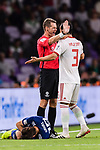 FIFA Referee Christopher Beath of Australia (C) talks to Ehsan Haji Safi of Iran (R) while Sakai Hiroki of Japan (bottom) lies injured during the AFC Asian Cup UAE 2019 Semi Finals match between I.R. Iran (IRN) and Japan (JPN) at Hazza Bin Zayed Stadium  on 28 January 2019 in Al Alin, United Arab Emirates. Photo by Marcio Rodrigo Machado / Power Sport Images