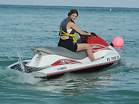 """SMG_FLXX_Mischa Barton_Jet Skiing_010212_02.JPG<br /> <br /> MIAMI BEACH, FL - JANUARY 2 :  Actress Mischa Barton goes jet skiing with red lipstick on her teeth  along with an unidentified man In Miami.  Mischa Anne Marsden Barton (born 24 January 1986) is a British-American fashion model, film, television, and stage actress. She began her acting career on the stage, appearing in Tony Kushner's Slavs! And took the lead in James Lapine's Twelve Dreams at New York's Lincoln Center. She made her screen debut, making a guest appearance on the American soap opera All My Children (1996). She then voiced a character on KaBlam! (1996-1997), an animated television series on Nickelodeon. Her first major film role was as the protagonist of Lawn Dogs (1997), an acclaimed drama co-starring Sam Rockwell. In 1997, she also landed a Calvin Klein campaign. She continued acting, appearing in major box office pictures such as the romantic comedy, Notting Hill (1999) and M. Night Shyamalan's psychological thriller, The Sixth Sense (1999). She later appeared in the independent drama, Lost and Delirious (2001) and played Evan Rachel Wood's girlfriend during a guest-arc on ABC's Once and Again (2001-2002). She is best known for her role as Marissa Cooper in the Fox television series The O.C. (2003-2006), for which she received two Teen Choice Awards and a Prism Award nomination. Entertainment Weekly named her the """"It Girl"""" of 2003.  On December 27, 2011 in Miami Beach, Florida   On January 02, 2012 in Miami Beach, Florida  (Photo By Storms Media Group)   <br /> <br /> People:  Mischa Barton"""