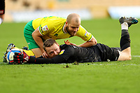 20th February 2021; Carrow Road, Norwich, Norfolk, England, English Football League Championship Football, Norwich versus Rotherham United; Viktor Johansson of Rotherham United keeps the ball in the area while he is under pressure from Teemu Pukki of Norwich City
