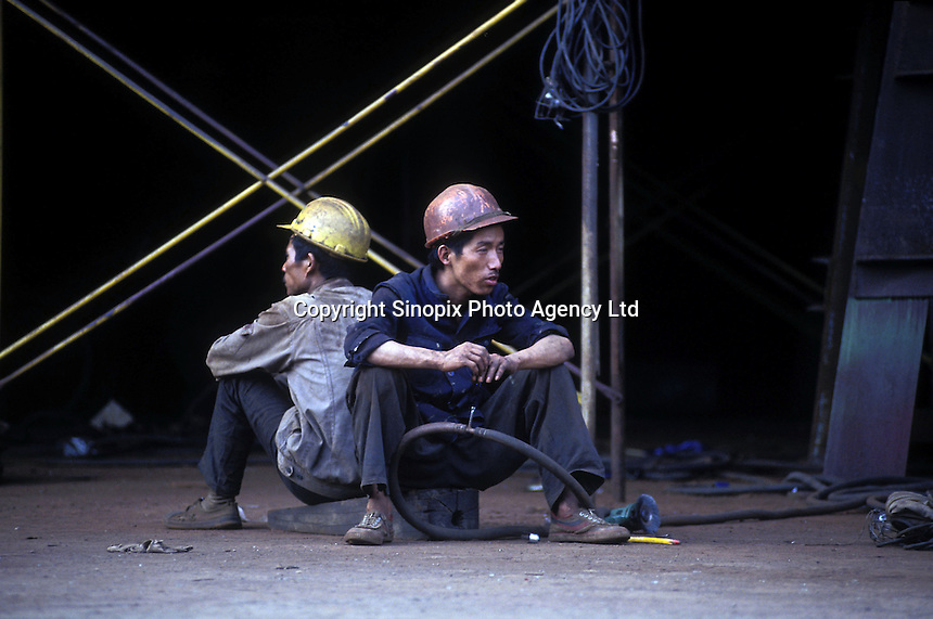 Construction workers take a break at the state-owned shipyard in Guangzhou, China.