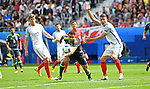Hal Robson Kanu of Wales makes a break for it while Gary Cahill of England protests in the second half at the Stade Bollaert-Delelis in Lens, France this afternoon during their Euro 2016 Group B fixture.