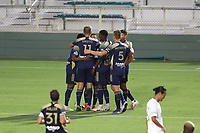 CARY, NC - AUGUST 01: Dre Fortune #8 celebrates his goal with teammates during a game between Birmingham Legion FC and North Carolina FC at Sahlen's Stadium at WakeMed Soccer Park on August 01, 2020 in Cary, North Carolina.