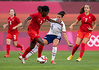 KASHIMA, JAPAN - AUGUST 2: Kadeisha Buchanan #3 of Canada fights for the ball with Carli Lloyd #10 of the USWNT during a game between Canada and USWNT at Kashima Soccer Stadium on August 2, 2021 in Kashima, Japan.