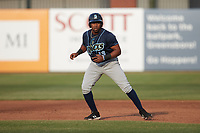 Omar Meregildo (13) of the Wilmington Blue Rocks takes his lead off of first base against the Greensboro Grasshoppers at First National Bank Field on May 25, 2021 in Greensboro, North Carolina. (Brian Westerholt/Four Seam Images)