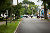 """Members prune trees along a street in the Hawthorne neighborhood during """"Circle the City with Service,"""" the Kiwanis Circle K International's 2015 Large Scale Service Project, on Wednesday, June 24, 2015, in Indianapolis. (Photo by James Brosher)"""