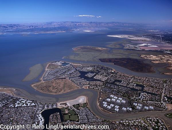 aerial photograph of Redwood Shores, Redwood City, San Mateo county, California toward San Jose; Belmont Slough is in the foreground, Steinberger Slough is in the middleground between Redwood Shores and Bair Island
