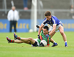 Michael O Dwyer of  Kilmurry Ibrickane in action against Liam Markham of Cratloe during their senior football final replay at Cusack park. Photograph by John Kelly.